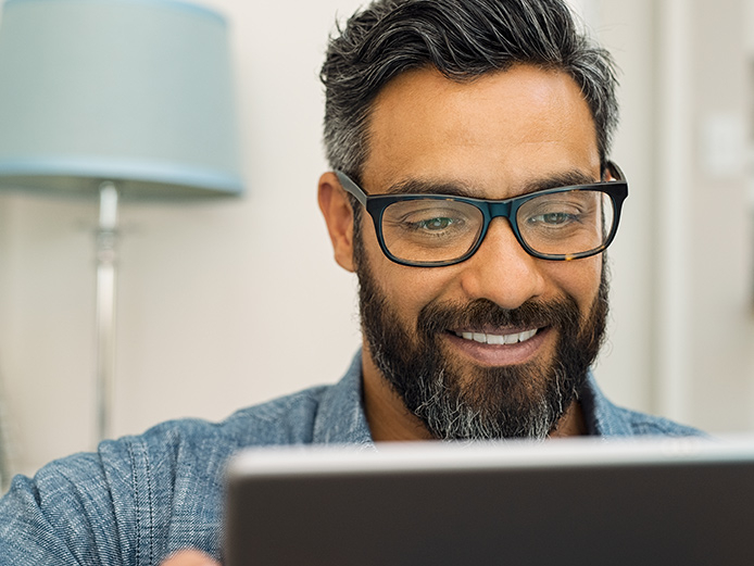Close up of middle aged man looking at computer screen